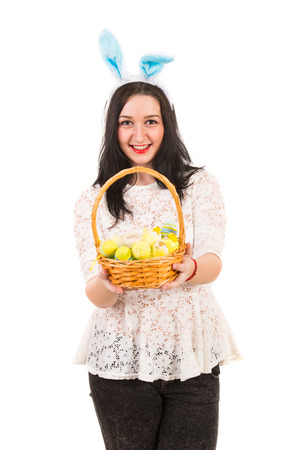 Happy woman giving Easter basket isolated on white background photo