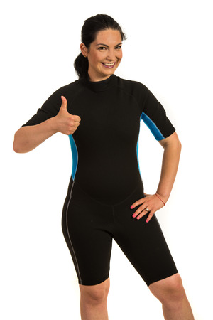 thumbup: Successful surfer woman in neoprene suit giving thumbs up isolated on white background Stock Photo