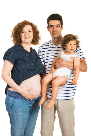 Family of pregnant mom,father and toddler boy isolated on white backgorund photo