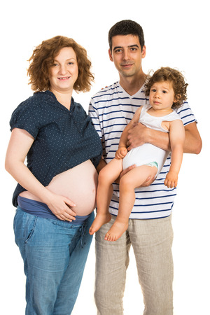 Beautiful family of pregnant mother ,father and boy isolated on white background photo