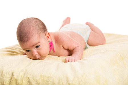 Laying newborn baby two months age having neck Kinesiology Tape for congenital torticollis