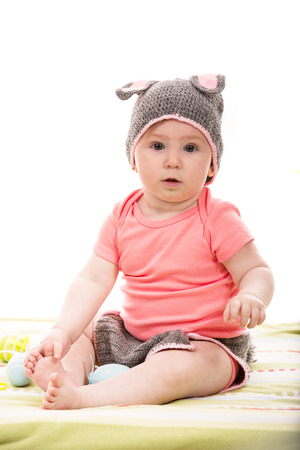 surprised baby: Surprised baby girl with crochet bunny hat with ears