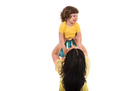 whie: Mother raise her son over her head isolated on whie background