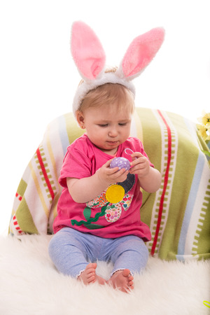 lilla: Beauty  baby girl with bunny ears holding Easter egg Stock Photo