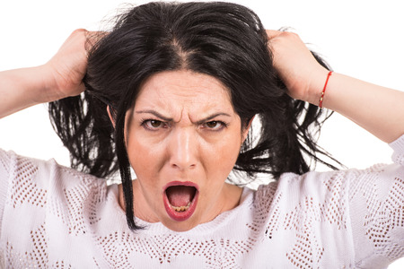 fidgety: Nervous woman yelling and pull  her hair isolated on white background