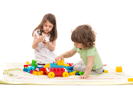 child's: Cute kids playing home with colorful cubes toys against white background