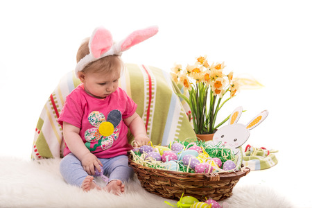lilla: Baby girl with bunny ears and Easter basket with eggs