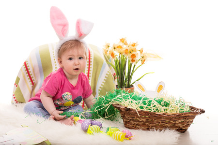 lilla: Beautiful baby girl sitting in Easter decor and wearing fluffy bunny ears