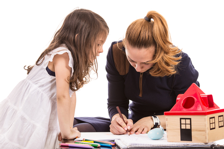 mum and child: Mother and daughter drawing on papers home