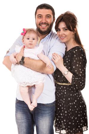 Happy elegant family with baby girl isolated on white background photo