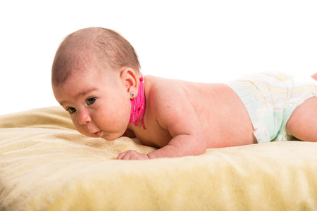 Newborn baby having torticollis neck waiting for massage