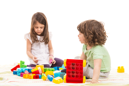 child's: Two little kids playing with bricks toys home