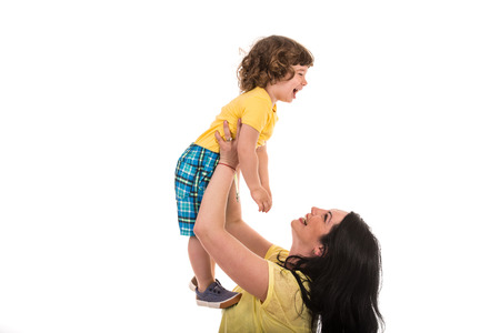 raising: Mother raising her laughing toddler son and having fun together isolated on white background Stock Photo