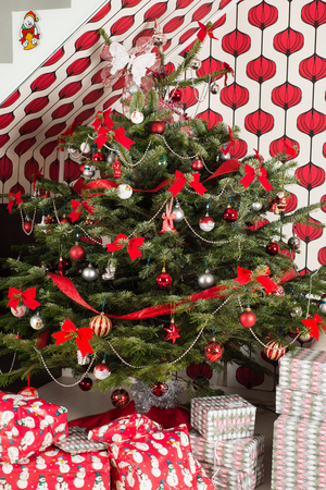 christmas tree decoration: Natural Chrismas tree  with gifts in living room