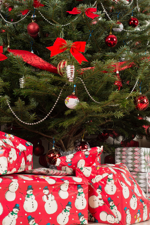 tree decorations: Beautiful natural Christmas tree with decorations and gigts under tree