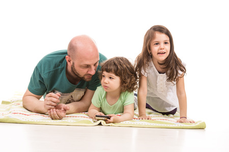 Father and two kids sitting on floor home photo