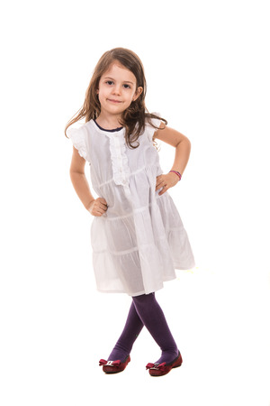 Beauty little girl in white dress posing isolated  on  white background photo