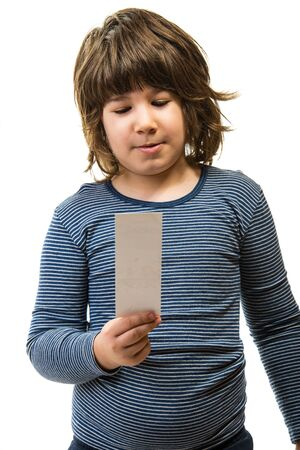 Boy holding and reading a bookmark isolated  on white background