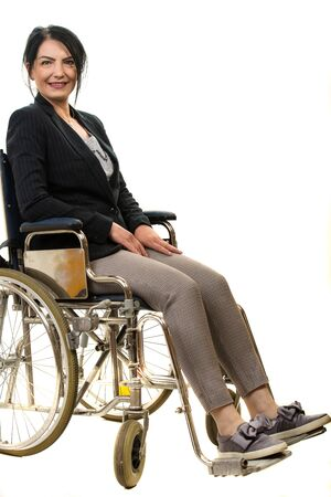 Cheerful businesswoman in wheelchair isolated on white background