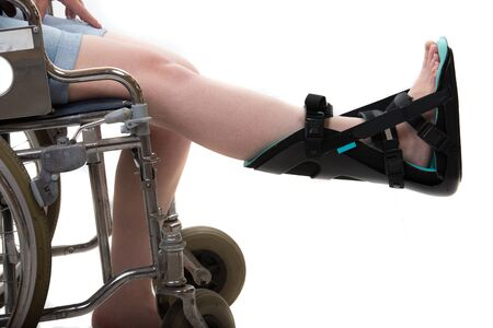Close up of woman in wheelchair and foot orthosis,night orthosis