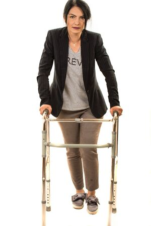 Injuried business woman with walking frame isolated on white background