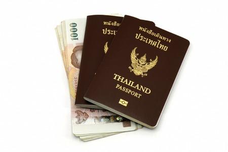 Thailand passport and Thai money isolated on white background photo