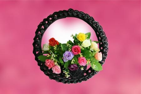 Rose basket on pink background photo