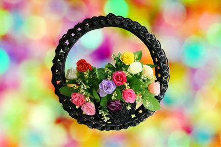 Rose basket isolated on white photo