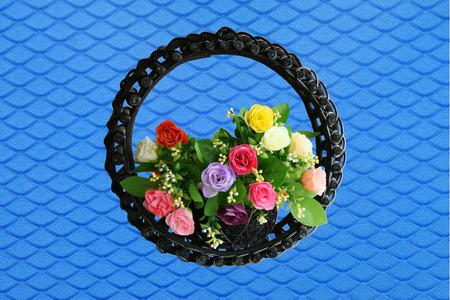 Rose basket on blue background photo
