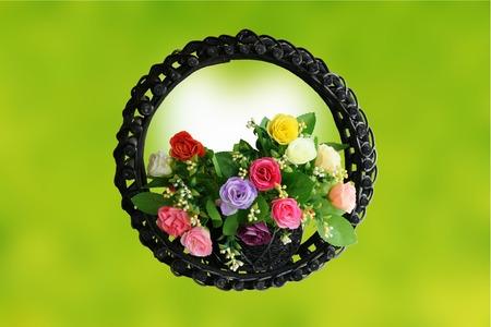 Rose basket on green background photo