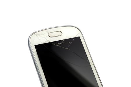 Broken smart phone isolated on white background photo