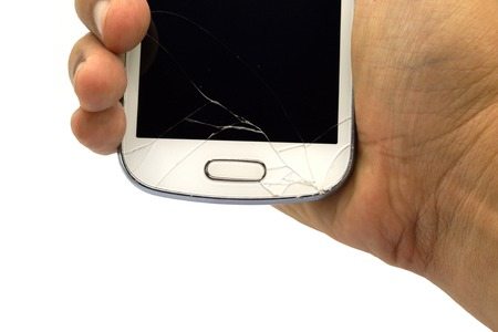 portable failure: Right Hand Holding Broken smart phone isolated on white background