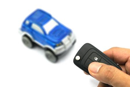 open autocar auto: Closeup of male hand holding remote control car key
