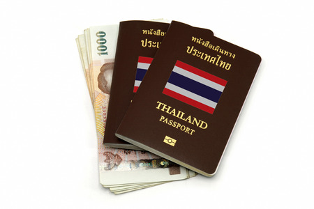 Thailand passport and Thai money isolated on white background for Travel or A.E.C. concept photo