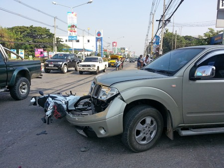 accident patient: CHIANGMAI THAILANDJANUARY 10 2013: Crash Accident Pickup Truck with Motorcycle at roadside in Chaingmai Northern Thailand.