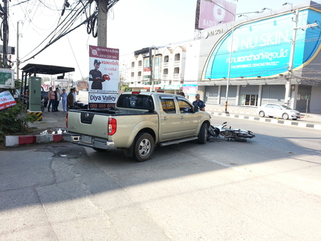 injurious: CHIANGMAI THAILANDJANUARY 10 2013: Crash Accident Pickup Truck with Motorcycle at roadside in Chaingmai Northern Thailand.