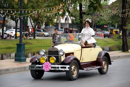 thai people: CHIANGMAI, THAILAND - FEBRUARY 2-2013 : Unidentified Thai people on the parade in ChiangMai Flower Festival 2013 in ChiangMai, Thailand.