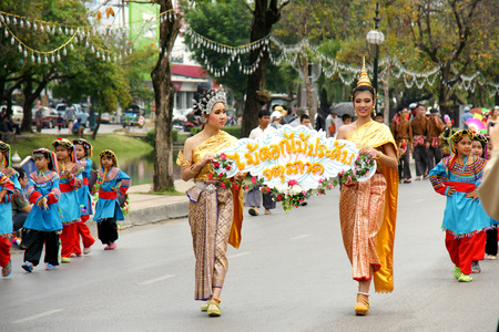 flower parade: CHIANGMAI, THAILAND - FEBRUARY 2-2013 : Unidentified Thai people on the parade in ChiangMai Flower Festival 2013 at ChiangMai, Thailand.