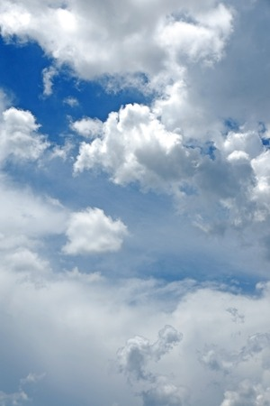 rainclouds: Beautiful rainclouds in the blue sky at Chiangmai city, Northern Thailand.