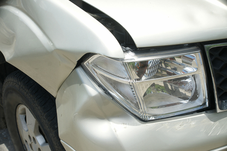 fender bender: A dent on the right front of a pickup truck damage from crash accident Stock Photo