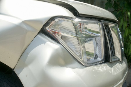 dent: A dent on the right front of a pickup truck damage from crash accident Stock Photo