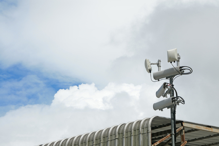wireless hot spot: Antennas of mobile cellular systems with wifi hot spot repeater and blue sky