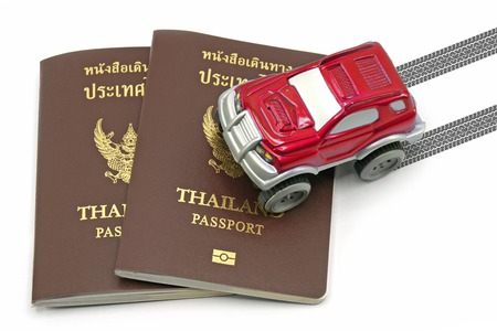 4wd: Thailand passport and red 4wd car for travel concept.
