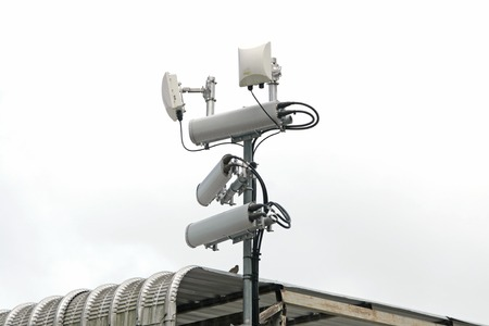 repeater: Antennas of mobile cellular systems with wifi hot spot repeater and blue sky