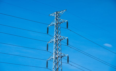power distribution: High voltage post or power transmission line tower and blue sky