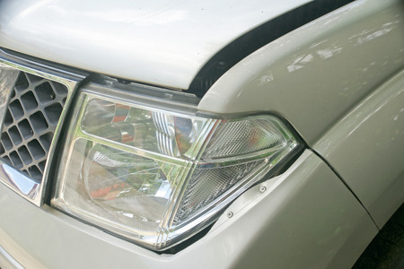 dent: A dent on the left front of a pickup truck damage from crash accident Stock Photo