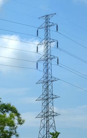 power line transmission: High voltage post or power transmission line tower and blue sky