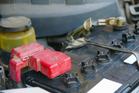12v: Dirty car battery with red positive polarity for auto concept Selective focus at positive symbol Stock Photo