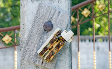 electric circuit: Old retro and broken dirty rust electric circuit breaker mounting on wooden outdoor panel