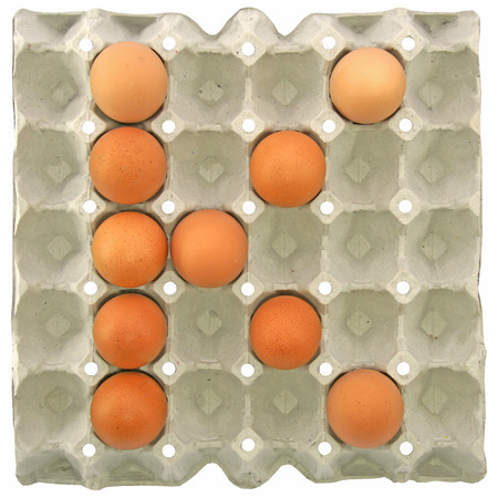 letter k: A letter K from the eggs in paper tray for food or nutrition concept Stock Photo